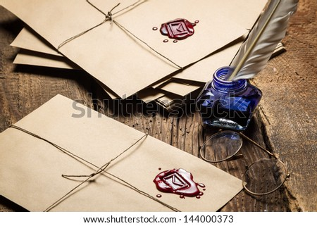 Vintage letters with red sealant and glasses - stock photo