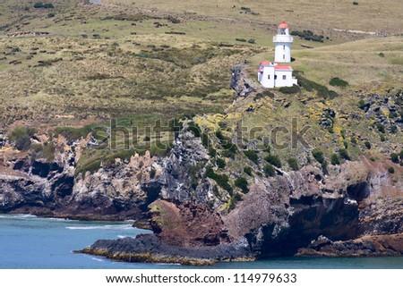 Vintage light house, Taiaroa Head, South Island, New Zealand. - stock photo