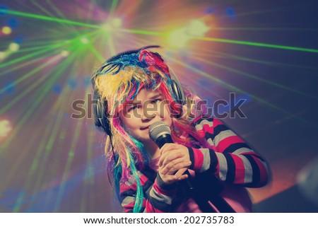 Vintage little children singing, dancing in disco club - stock photo
