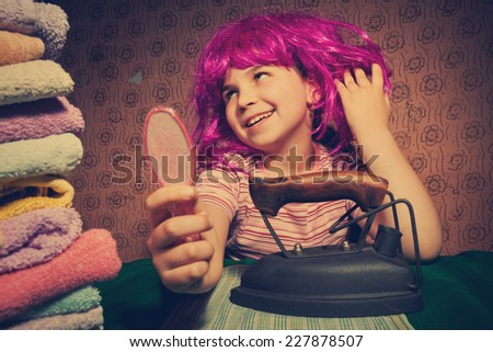 Vintage little girl playing, working at home - stock photo