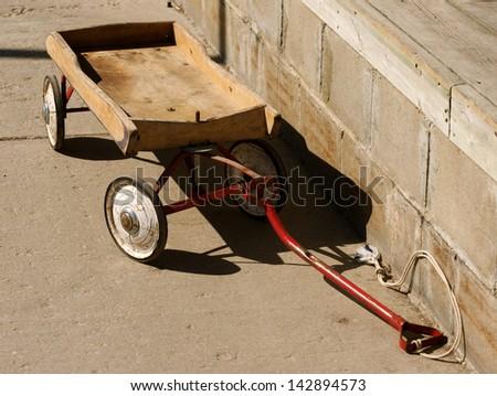 Vintage, little, wood wagon, symbolic of childhood - stock photo