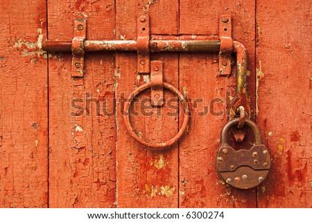 Vintage Lock on Bright Red Door - stock photo