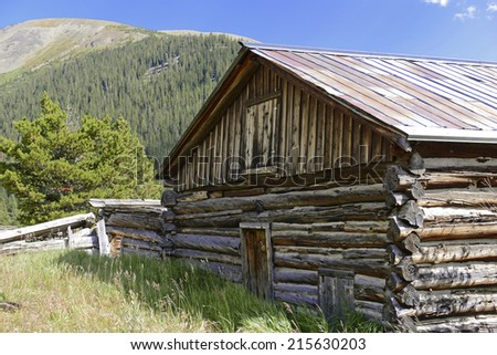 Vintage log cabin in mining town, Rocky Mountains, USA - stock photo