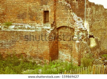 Vintage look Ancient Roman City Wall ruins, London, UK - stock photo