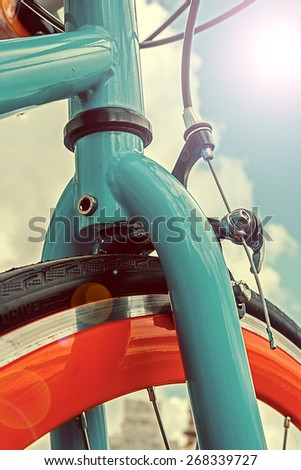 Vintage look at one bicycle detail in a lens flare reflection. - stock photo