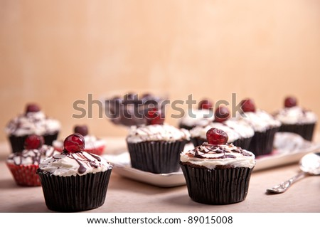 vintage look picture of cherries cupcakes - stock photo