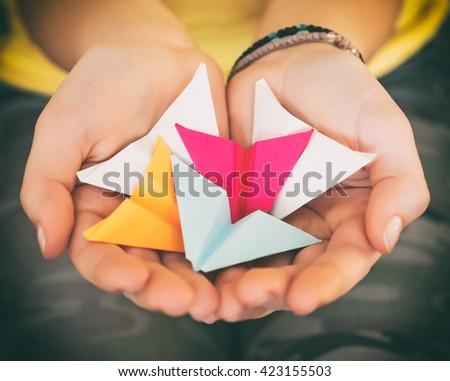 Vintage Look: teenage girl holding paper airplanes - stock photo