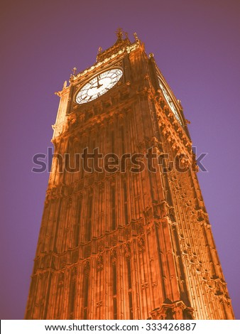 Vintage looking Big Ben at the Houses of Parliament aka Westminster Palace at night in London, UK - stock photo