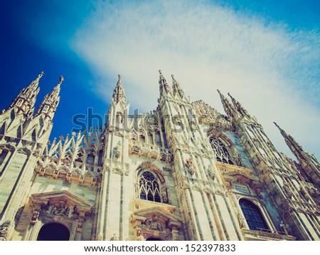 Vintage looking Duomo di Milano gothic cathedral church, Milan, Italy - stock photo