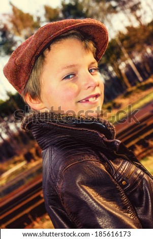 vintage looking kid with pilot jacket and beret, instagram style effect added - stock photo