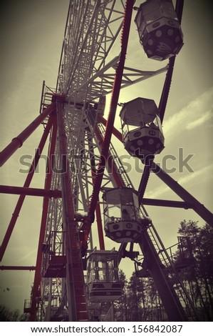 Vintage looking photo of Ferris wheel - stock photo