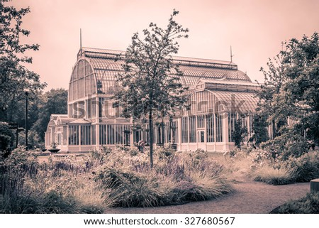 Vintage looking picture of an old greenhouse in the botanical garden in Gothenburg, Sweden - stock photo