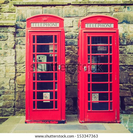 Vintage looking Traditional red telephone box in London, UK - stock photo