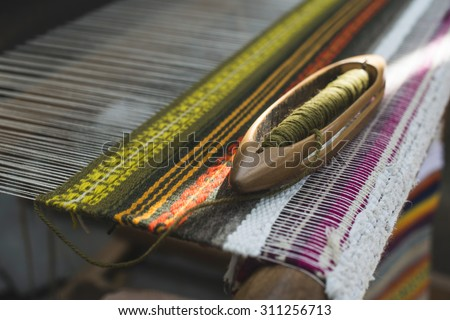 Vintage loom and yarn. Knitting carpet - stock photo