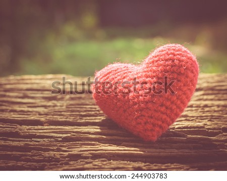Vintage love heart on wooden texture background , valentines day concept - stock photo