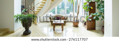 Vintage luxury mansion interior with spiral stairs, panorama - stock photo