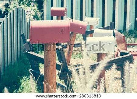 Vintage mailbox In front of a House. - stock photo