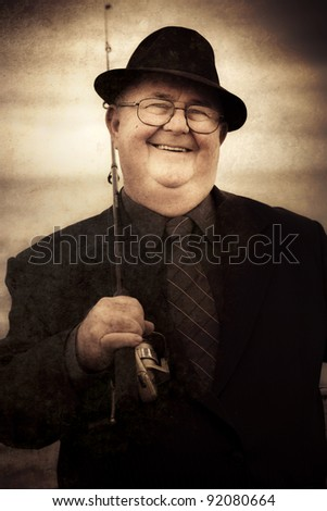 Vintage Male Fisherman Laughing When Holding Rod And Tackle While Standing On A Rocky Beach Shoreline In A Nostalgic Portrait From The Past - stock photo