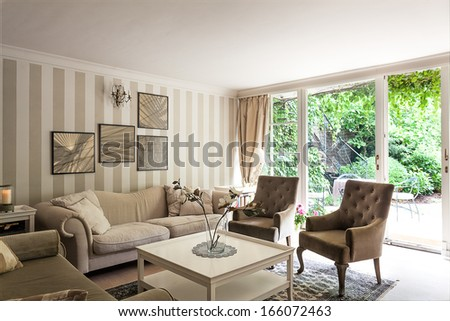 Vintage mansion - a corner with a striped wall in a luxurious apartment - stock photo