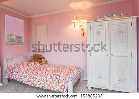 Vintage mansion - a pink bedroom of a little girl - stock photo