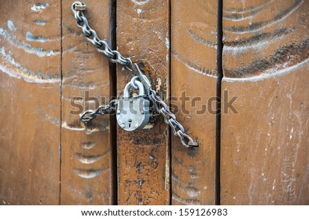 Vintage master key on a wooden antique door  - stock photo