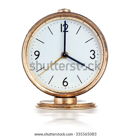 Vintage mechanical alarm clock showing four o'clock isolated over white - stock photo