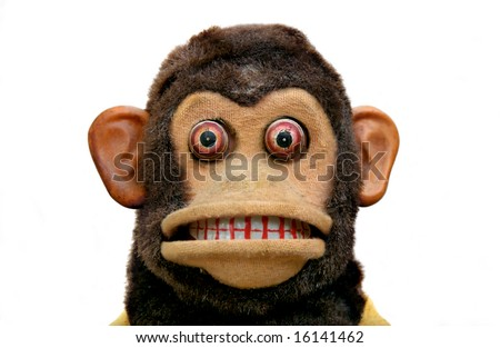 Vintage mechanical monkey toy with cymbals, head and face from front - stock photo