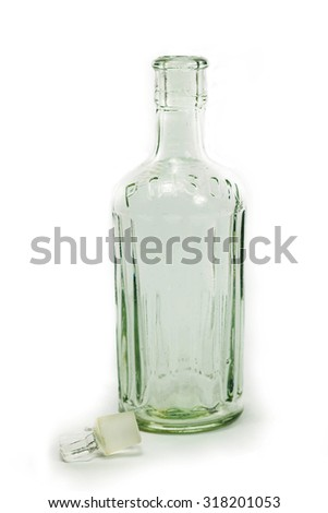 Vintage medical bottle of clear glass  - stock photo