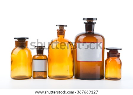 Vintage medicine pharmacy bottles on white background with blank labels - stock photo