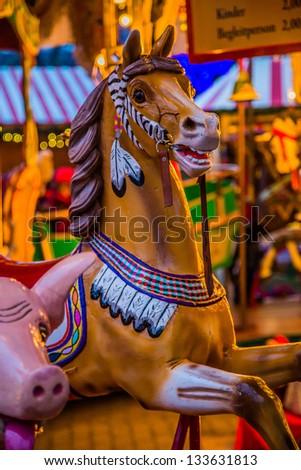 Vintage merry-go-round wooden horses - stock photo