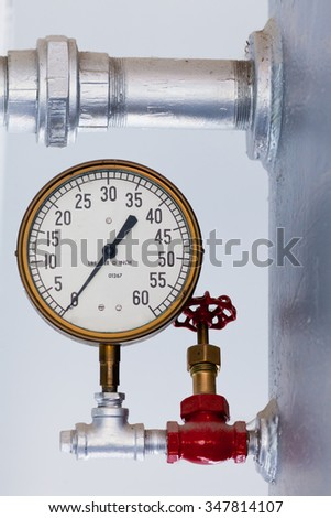 Vintage metal boiler tank with steampunk metal pressure gauge with scale in pounds lbs per square inch up to 60 - stock photo
