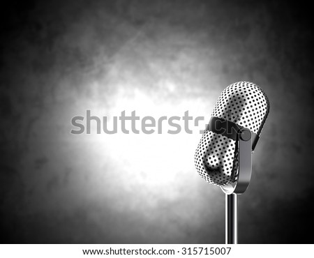 Vintage microphone isolated on black and white background - stock photo