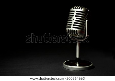 Vintage microphone on a black background - stock photo