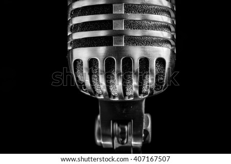 Vintage microphone on black background - stock photo