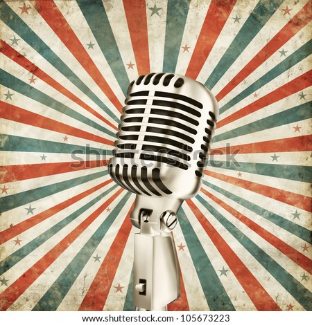 vintage microphone on grunge ray background - stock photo