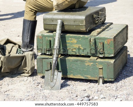 vintage military suitcase, army box of ammunition and Sapper shovel - stock photo