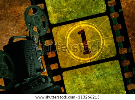 Vintage 8mm film projector with reels, colorful background with grunge textured film frames and a number one in countdown - stock photo