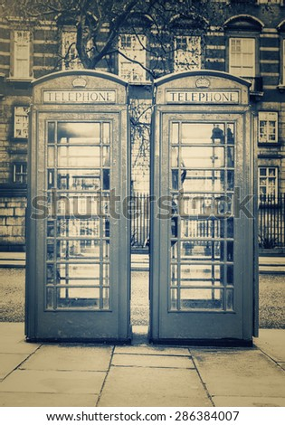 Vintage monochrome image of the famous phone booths in London - stock photo
