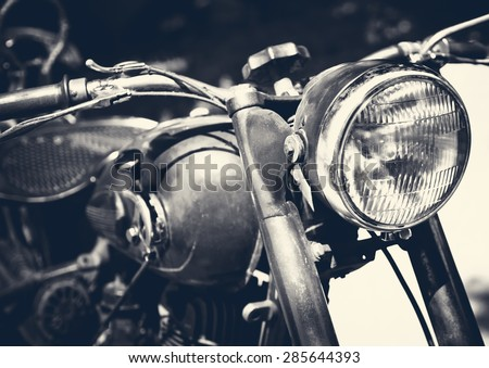 Vintage motorbike, focus on a headlamp. Retro motorcycle with headlight on black and white colors. - stock photo