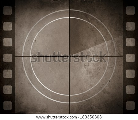 Vintage movie background with film strip boarder and countdown frame - stock photo