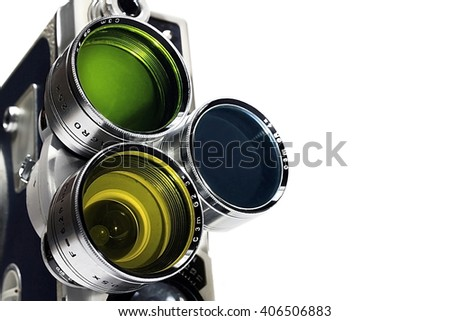 Vintage movie camera lens with color filters isolated on white - stock photo
