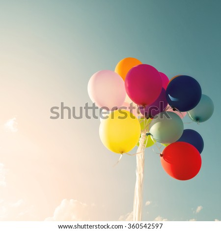 Vintage multicolored balloons of birthday party. Instagram retro filter effect - stock photo