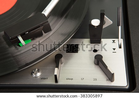 vintage music player turntable with lp record - stock photo