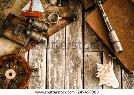 Vintage nautical things on wood background. Grunge retro toned image with copy space. Travel and adventure concept. Top view - stock photo
