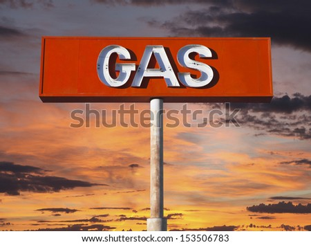 Vintage neon gas sign with sunset sky. - stock photo