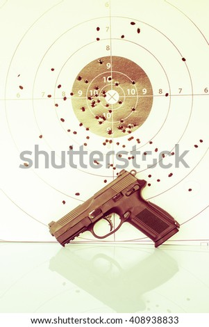 vintage of paper target gun pistol magazine and bullet. - stock photo