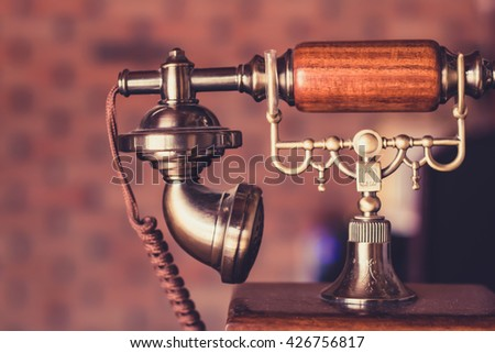 Vintage of  telephone on the counter. - stock photo