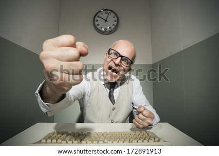 Vintage office worker angry and yelling at computer. - stock photo