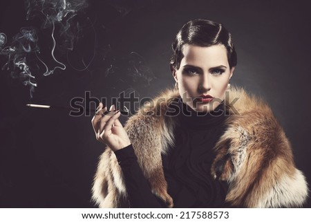 Vintage, old. Attractive girl with cigarette - stock photo