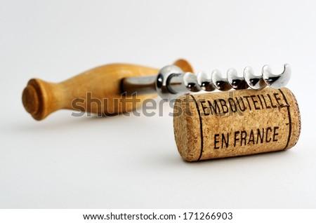 vintage old corkscrew and wine cork with inscription embouteille en France - stock photo